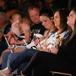 Family members attend a vigil to honor the life and service of Marine Staff Sgt. Taylor Hooverat the Capitol in Salt Lake City on Sunday, Aug. 29, 2021. Hoover was one of the 13 U.S. service members killed by the terrorist attack at Hamid Karzai International Airport in Kabul, Afghanistan.