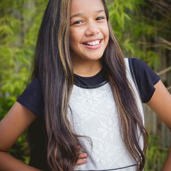 Nicole Luz, 14, gathered national attention when she competed on a reality TV show and wore her Young Women medallion.