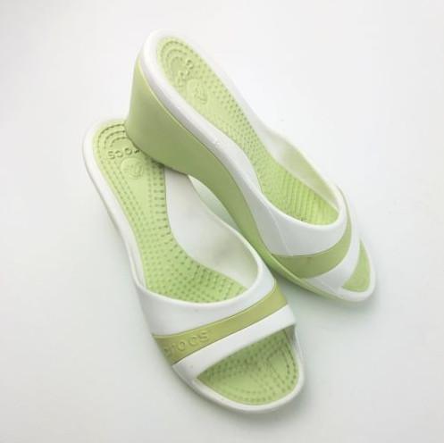 A pair of green and white Sassari crocs.