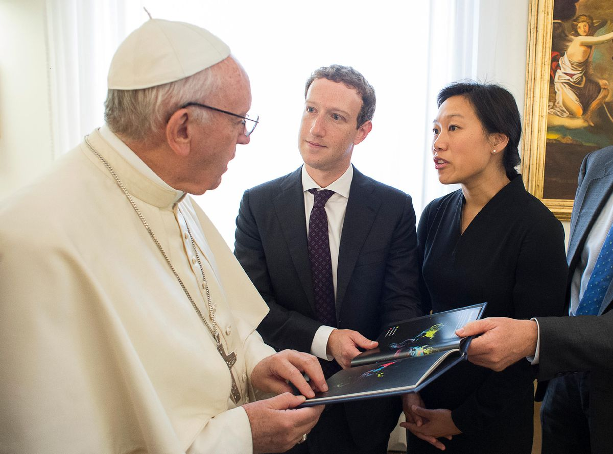 Mark Zuckerberg and Priscilla Chan meeting the Pope and holding a book.