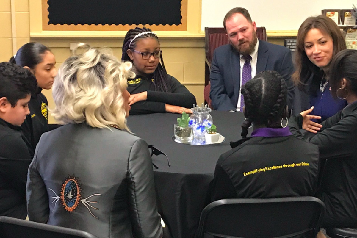 Tennessee Education Commissioner Penny Schwinn (right) speaks with students during a visit to LEAD Neely's Bend, a state-run charter school in Nashville. (Photo courtesy of LEAD Public Schools)
