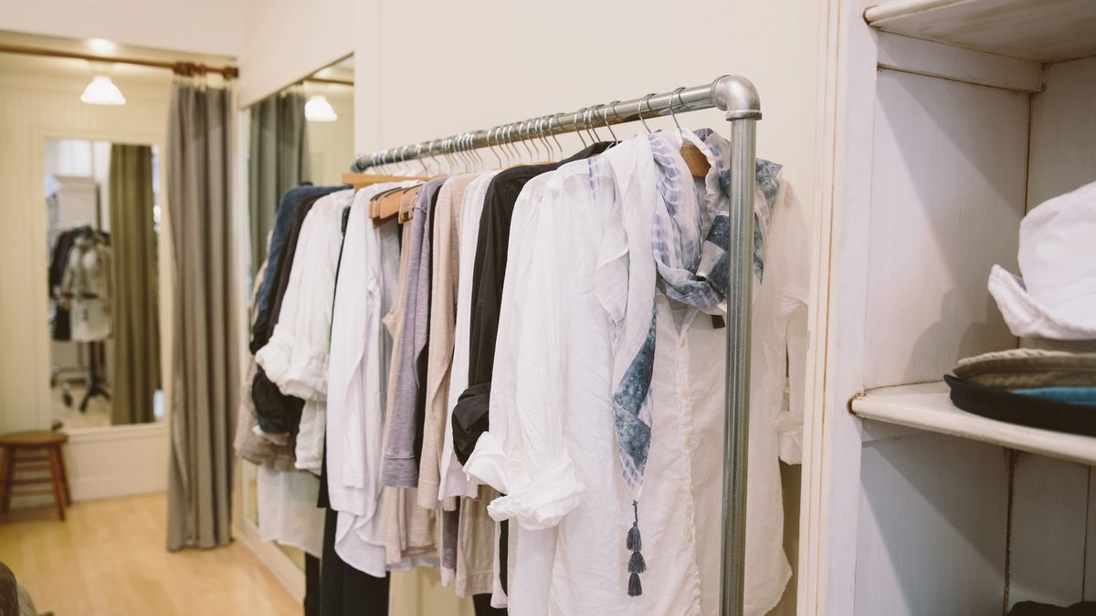 Clothes on a rack in a boutique.