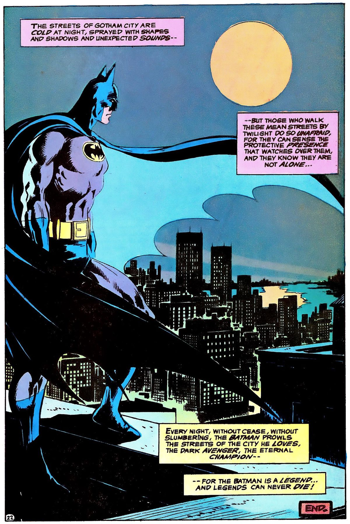 Batman stands on a rooftop overlooking city streets in the light of a full moon. His costume is blue on grey, with a black bat on a yellow oval, in