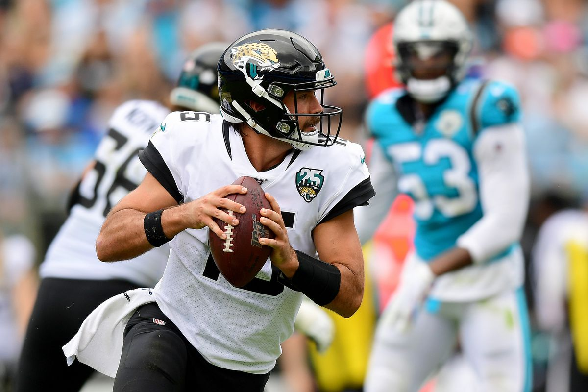 Gardner Minshew of the Jacksonville Jaguars runs with the ball in the third quarter during their game against the Carolina Panthers at Bank of America Stadium on October 06, 2019 in Charlotte, North Carolina.
