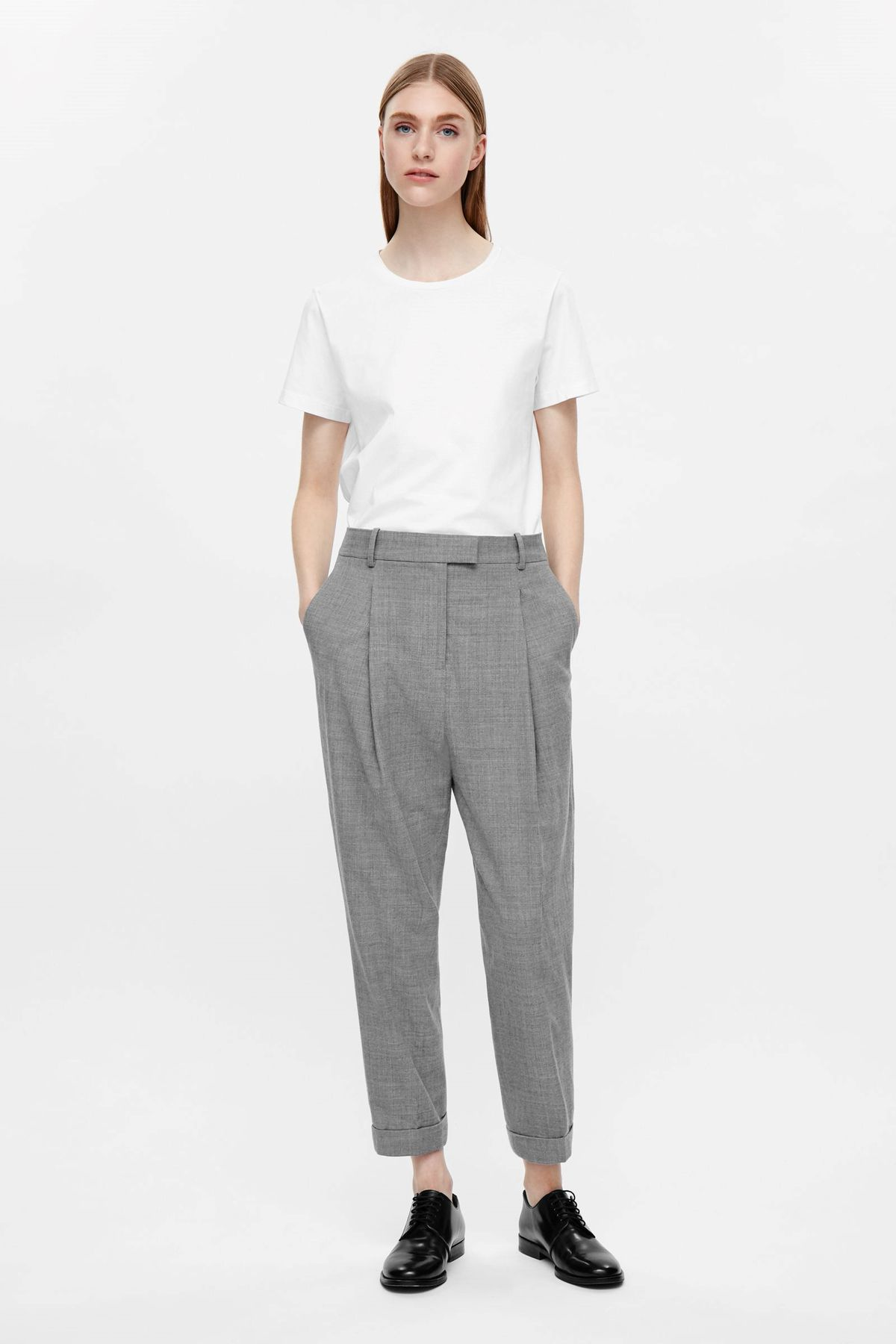 231a1720b72be Woman in white t-shirt, gray tapered trousers and black oxfords.