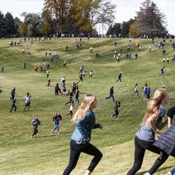 Spectators hustle between points on the course during the 4A Girls State Cross-Country Championships at Sugar House Park in Salt Lake City on Wednesday, Oct. 23, 2019.