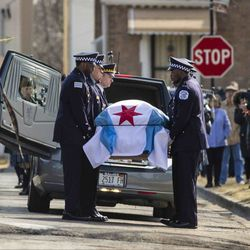 Pallbearers carry in the casket for Chicago Police Officer John P. Rivera before the start of his funeral at the Church Of Annunciata on Friday , March 29, 2019. | Ashlee Rezin/Sun-Times