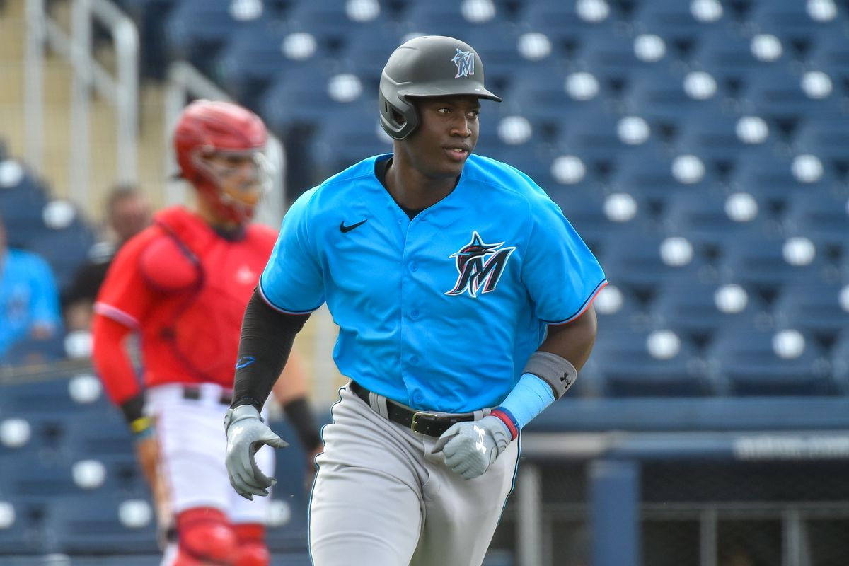 Jesús Sánchez of the Miami Marlins runs towards first base after hitting a base hit during the fourth inning of the spring training game against the Washington Nationals