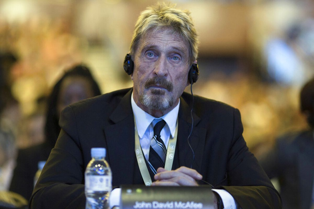 Software entrepreneur John McAfee listens during the 4th China Internet Security Conference (ISC) in Beijing.