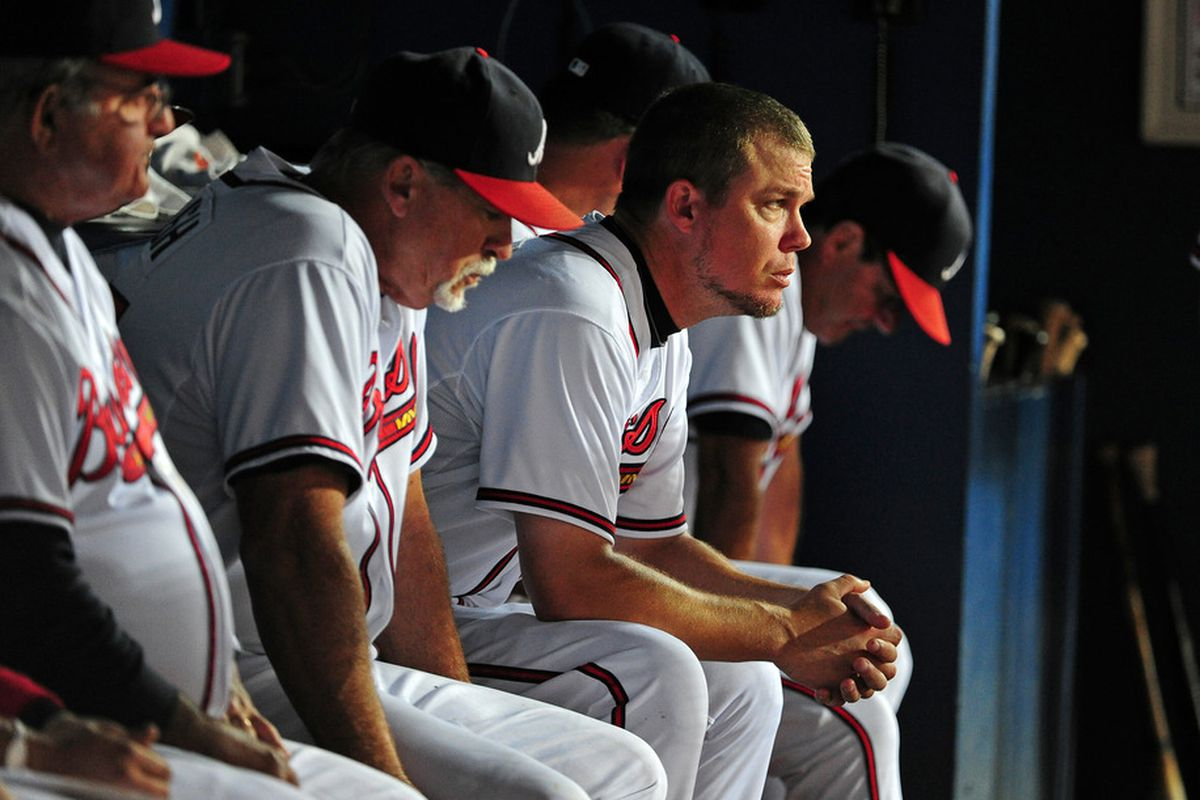 ATLANTA - SEPTEMBER 27: Chipper Jones #10 of the Atlanta Braves watches the action late in the game against the Philadelphia Phillies at Turner Field on September 27, 2011 in Atlanta, Georgia. (Photo by Scott Cunningham/Getty Images)