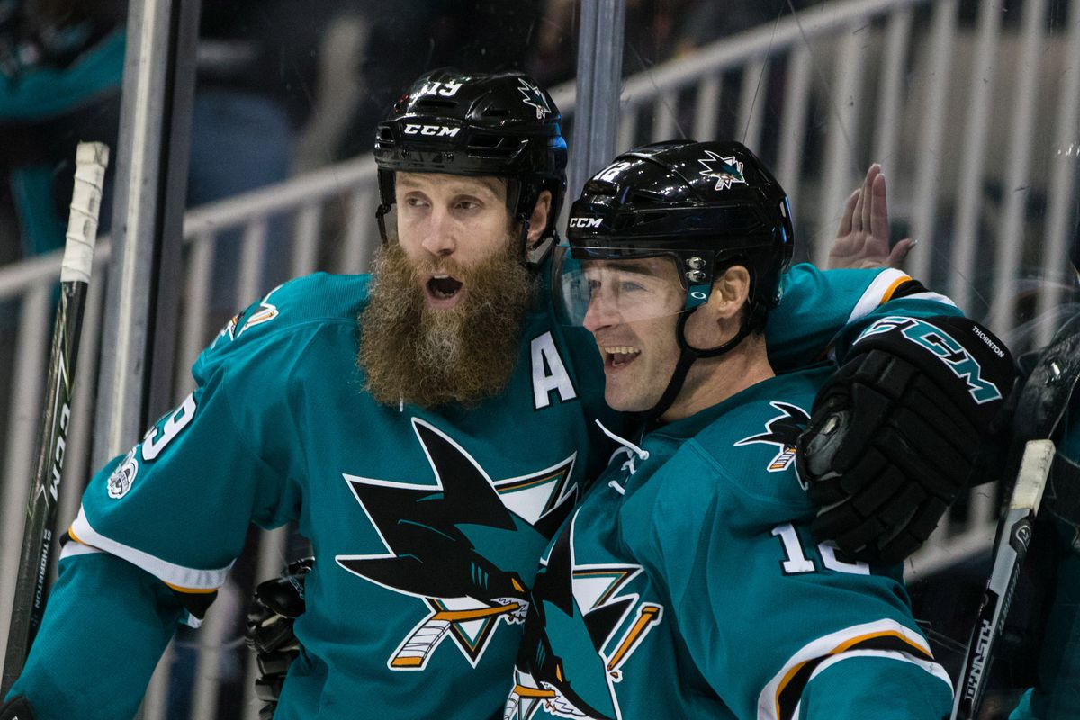 Jan 31, 2017; San Jose, CA, USA; San Jose Sharks left wing Patrick Marleau (12) celebrates with center Joe Thornton (19) after scoring a goal against the Chicago Blackhawks in the second period at SAP Center at San Jose.
