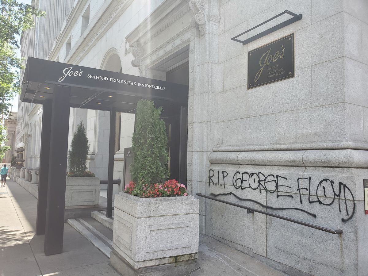 """Graffiti on the wall at the high-end surf and turf restaurant Joe's Seafood reads """"R.I.P. George Floyd."""""""