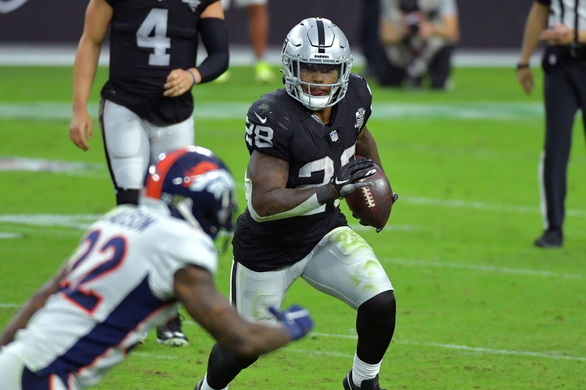 Las Vegas Raiders running back Josh Jacobs  carries the ball during a play against the Denver Broncos in the second half at Allegiant Stadium