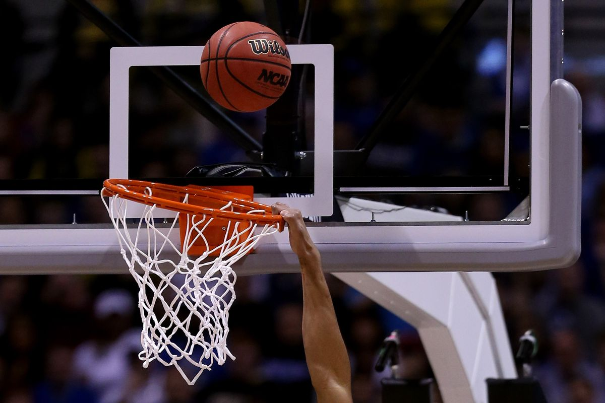 Here's a nondescript picture of a guy dunking a basketball.