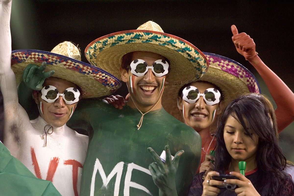 SAN DIEGO, CA - MARCH 29:  Fans of Mexico celebrate prior to the game against Venezuela at Qualcomm Stadium on March 29, 2011 in San Diego, California. (Photo by Kent Horner/Getty Images)