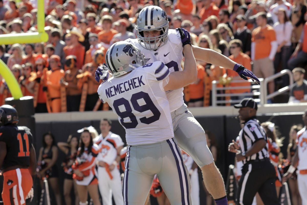 There's nothing like two studly fullbacks sharing a manly chest bump.