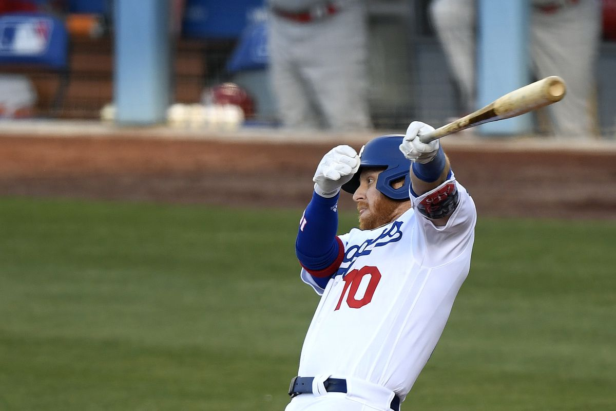 Justin Turner of the Los Angeles Dodgers hits an RBI single scoring Mookie Betts, to tie the game 1-1 with the St. Louis Cardinals during the first inning at Dodger Stadium on June 02, 2021 in Los Angeles, California.