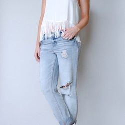 """<a href=""""http://www.shopvonz.com/collections/tops-1/products/fringe-tank"""">Ark & Co Fringe Cropped Tank</a>, $46"""