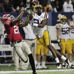 FILE - In this Dec. 3, 2011, file photo, Georgia wide receiver Malcolm Mitchell (26) tries to catch a pass as LSU defensive back Tharold Simon (24) knocks the ball away during the first half of the Southeastern Conference championship NCAA college football game in Atlanta. Georgia has scored more than 40 points in four straight games for the first time, and quarterback Aaron Murray might now have another top weapon.  Mitchell may be back on offense this week against Tennessee after spending most of the first four games at cornerback.