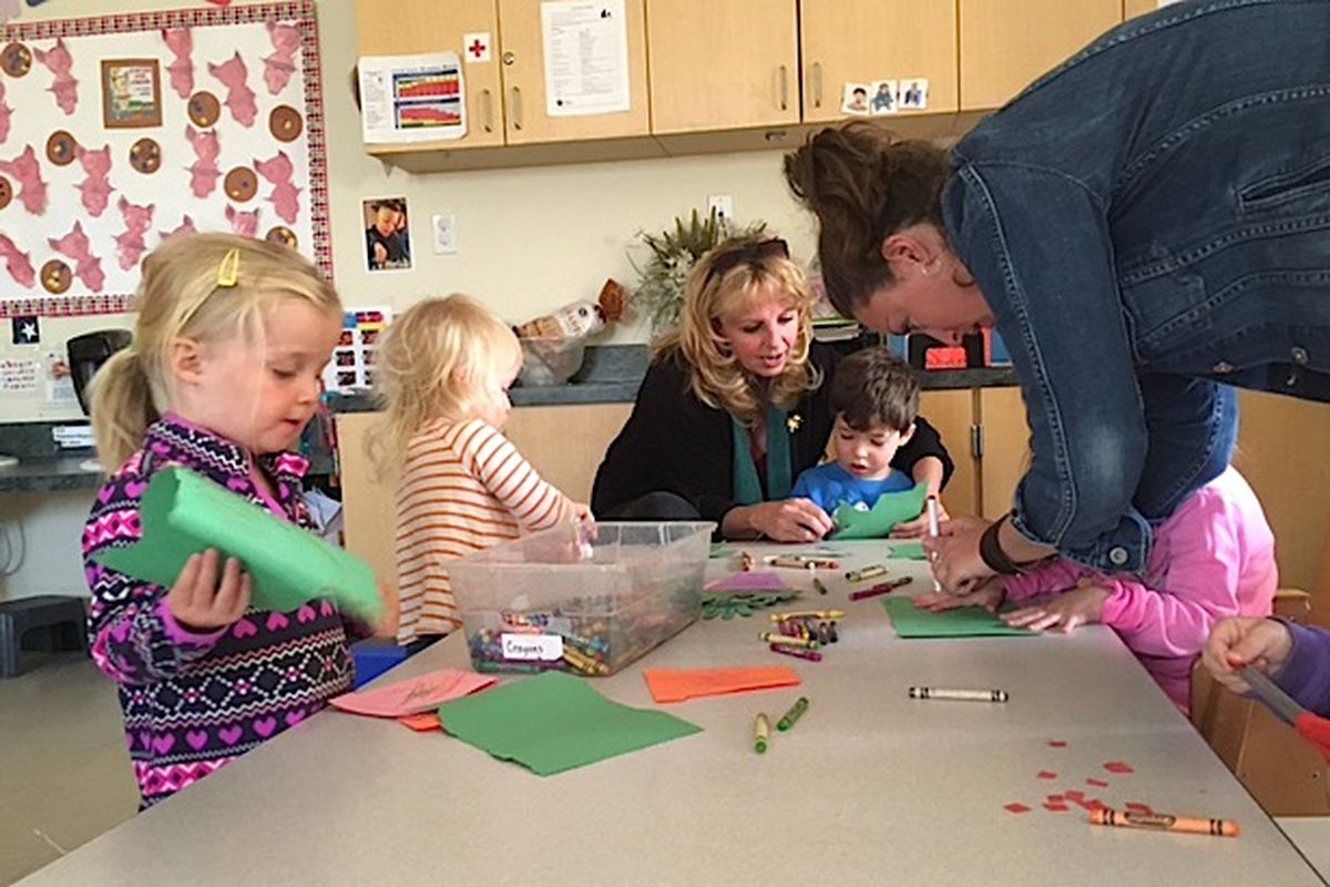 Pam Sturgeon, an early childhood mental health consultant, works with a boy at TLC Learning Center in Longmont.