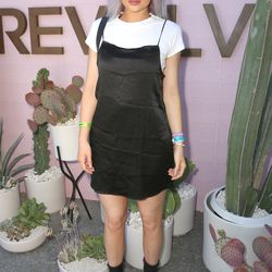Kylie Jenner in an Are You Am I t-shirt, Trois Clauda dress, Louis Vuitton scarf, and Ann Demeulemeester boots.