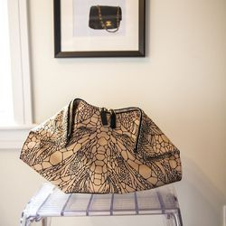 """Rachel's Alexander McQueen De-Manta Butterfly-Print Clutch Bag. """"My gay husband Hung – he's wonderful, and he gave me this McQueen bag for my last birthday. It's just so McQueen-y and it's not trying to hard, and it's not one of those evening bags that's"""