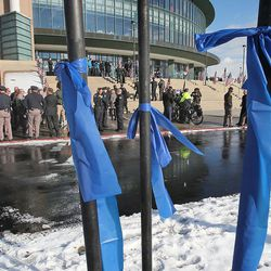 Blue ribbons surround the Maverik Center as people arrive for the funeral of Unified police officer Doug Barney at the Maverik Center Monday, Jan. 25, 2016, in West Valley City. Barney was killed in the line of duty on Jan. 17, 2016.