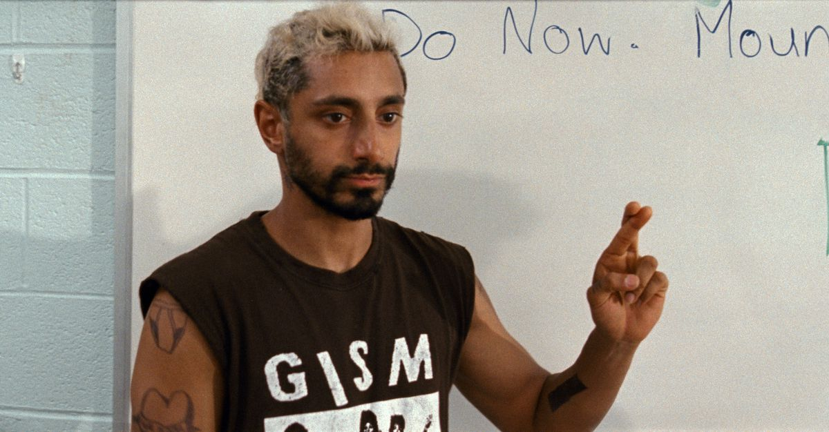 A bleach blonde Riz Ahmed in The Sound of Metal crossing his fingers