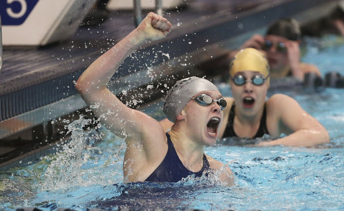 Ridgeline's Carly Eubanks, left, and Snow Canyon's Gretchen Snelders tie for first in the 100-yard freestyle in the 4A state swimming meet in Provo on Saturday, Feb. 8, 2020.