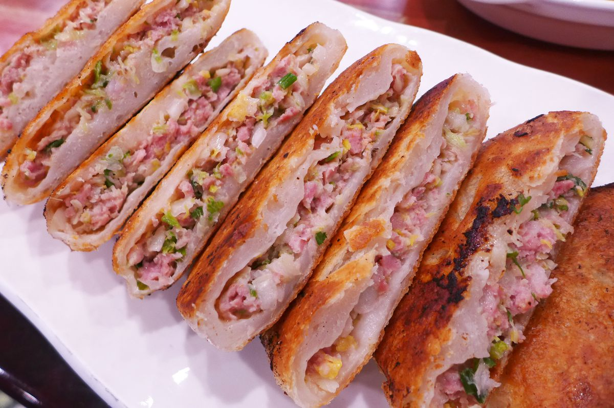 A stuffed pastry filled with pork and cabbage.