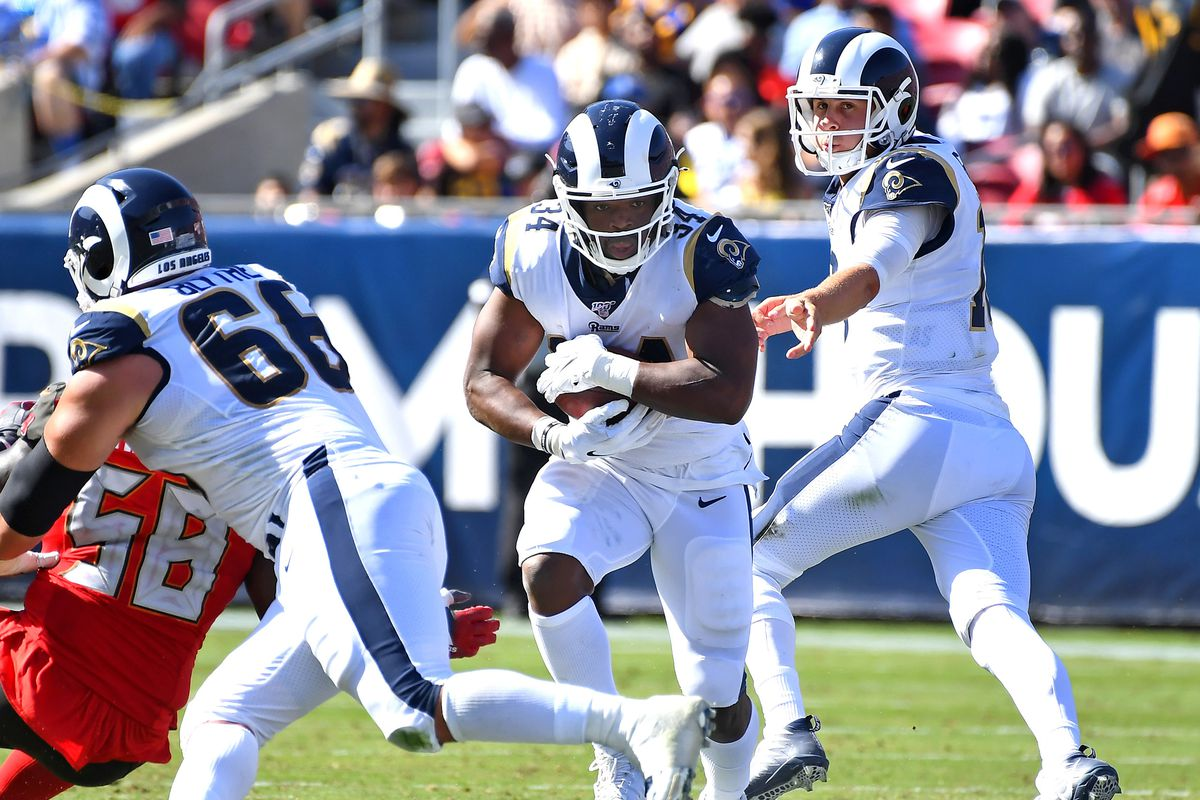 Los Angeles Rams running back Malcolm Brown takes a handoff from quarterback Jared Goff against the Tampa Bay Buccaneers in the second half at the Los Angeles Memorial Coliseum.