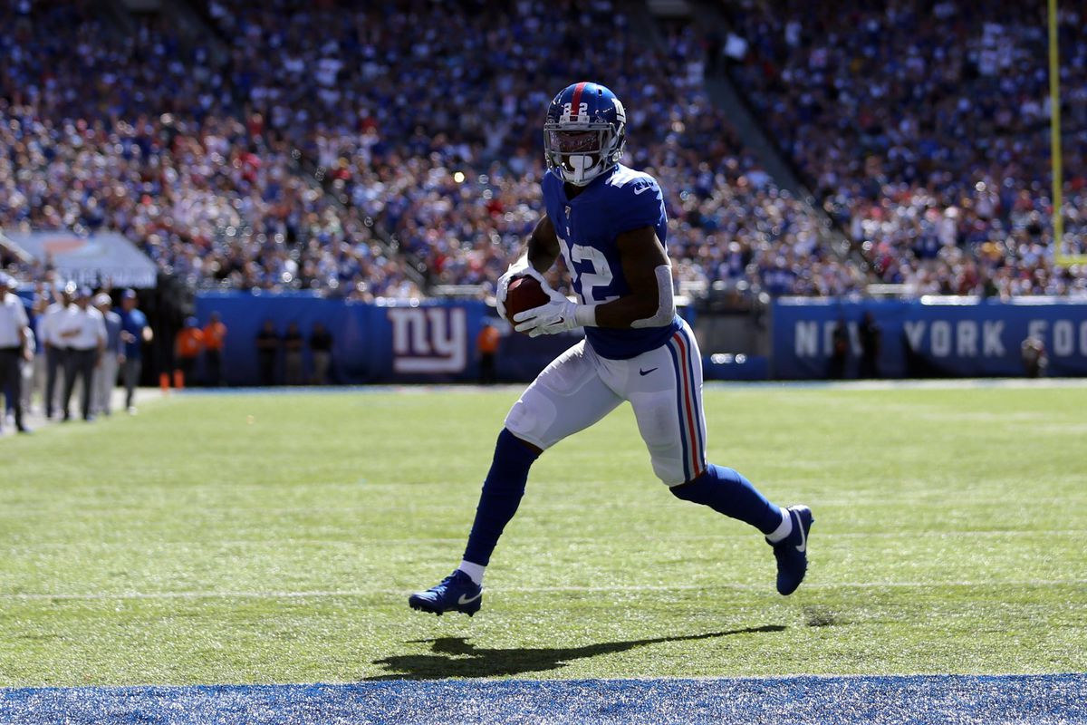 New York Giants running back Wayne Gallman runs for a touchdown against the Washington Redskins during the first quarter at MetLife Stadium.