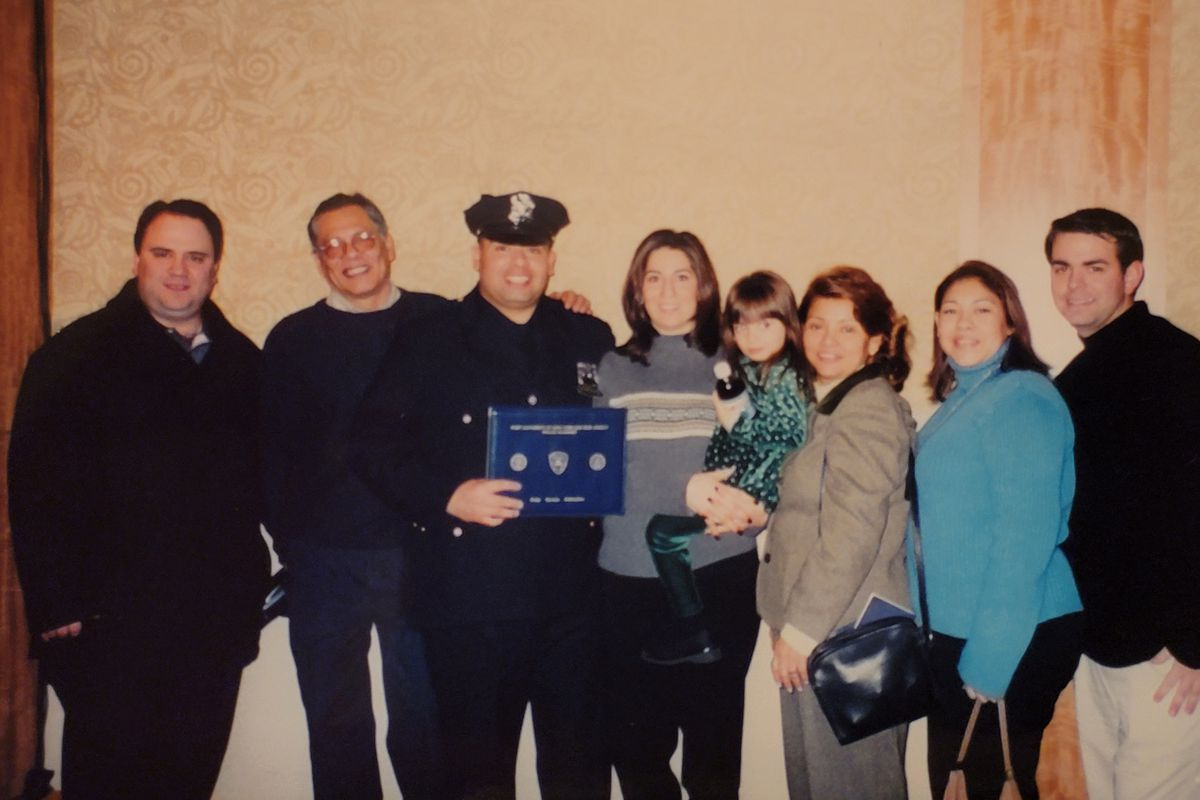 Jimeno alongside his wife, Allison, and daughter, Bianca, at his Port Authority graduation at the World Trade Center on Jan. 19, 2001.