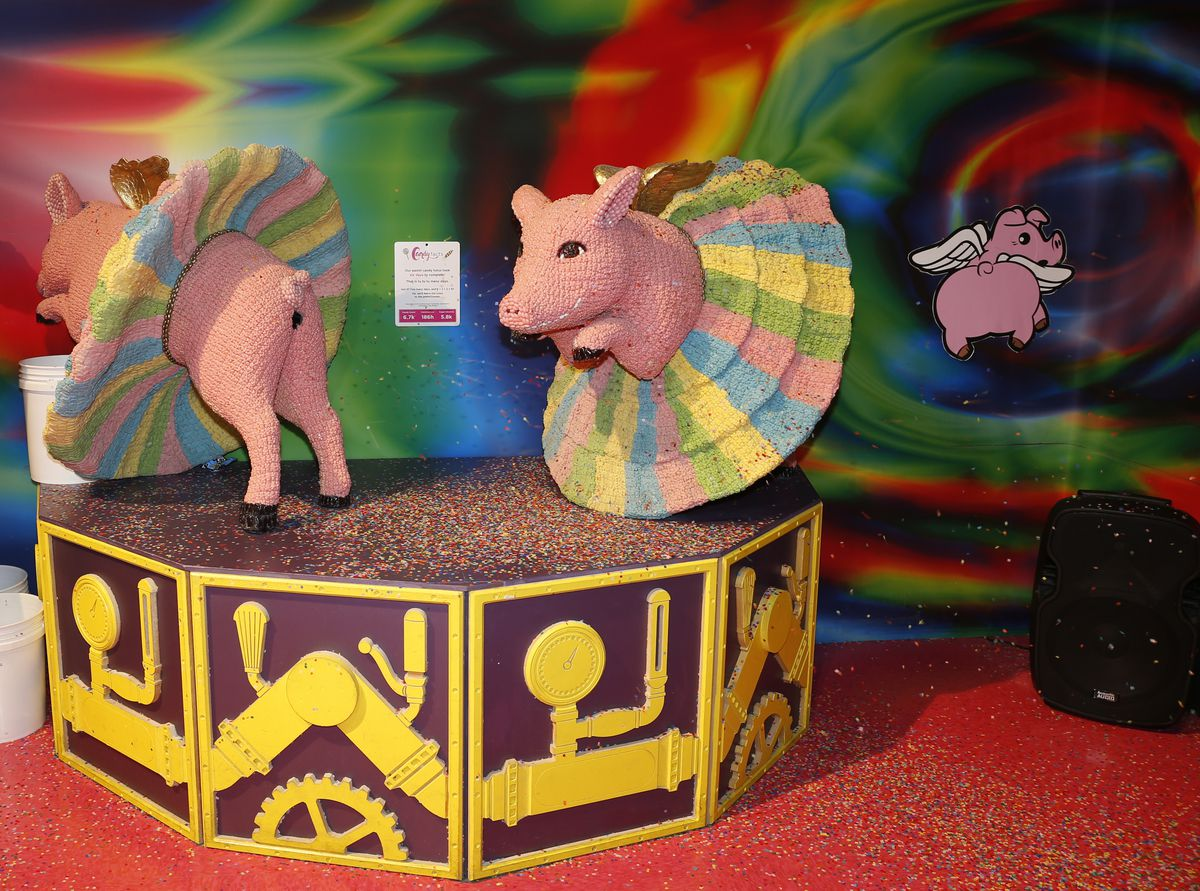 pigs made out of candy in candytopia art exhibit