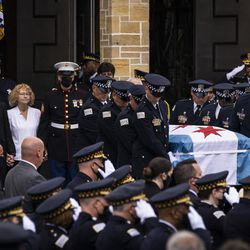 Family members, including her mother, Elizabeth French, walk behind as pallbearers carry the casket to the hearse for Chicago Police Officer Ella French after her funeral at St. Rita of Cascia Shrine Chapel, Thursday, Aug. 19, 2021. French was fatally shot and her partner was critically wounded while in the line of duty on Aug. 7 in West Englewood.