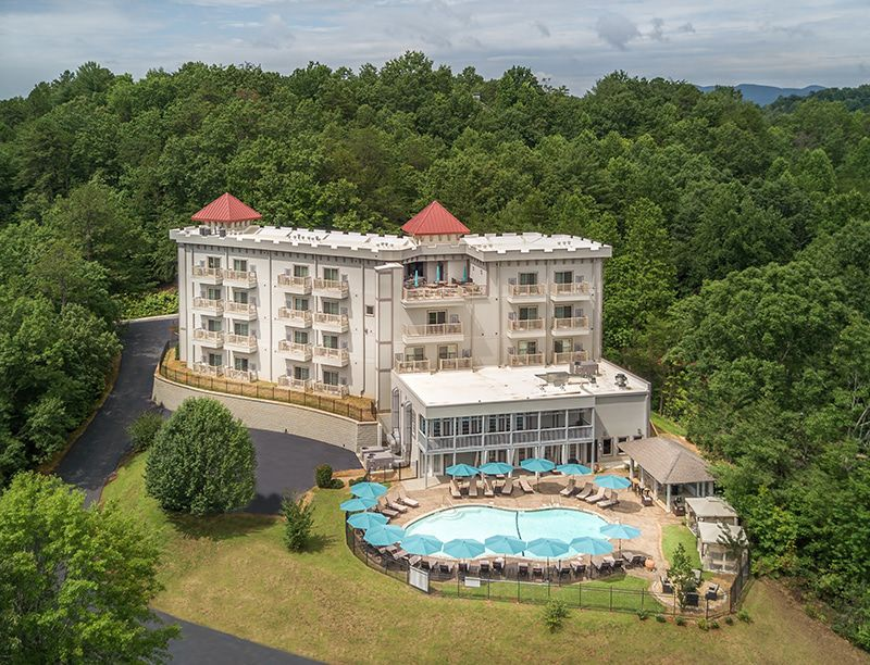 Aerial view of hotel with swimming pool.