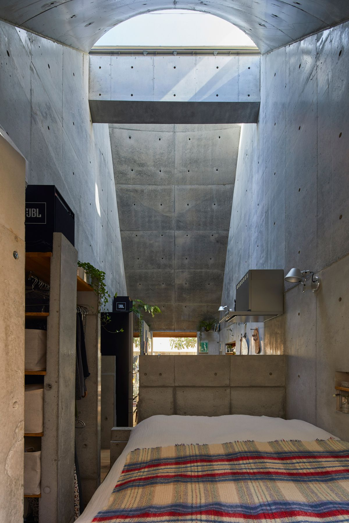 Bedroom separated by concrete wall