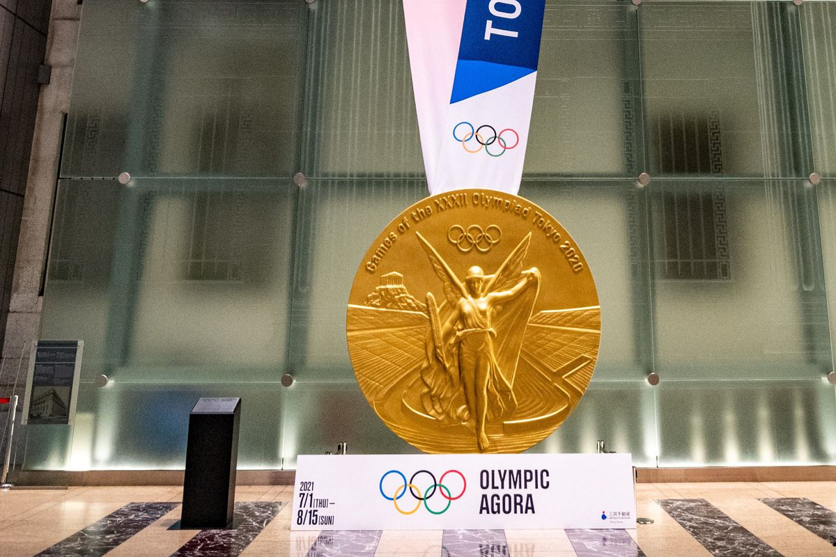 This picture shows a large-scale reproduction of the Tokyo 2020 Olympic Games gold medal as part of the Olympic Agora event at Mitsui Tower in Tokyo on July 14, 2021.