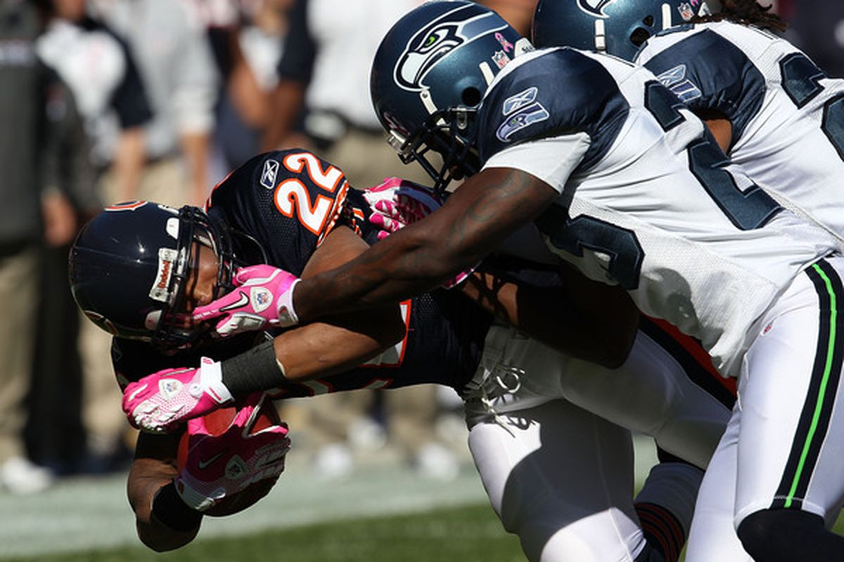CHICAGO - OCTOBER 17: Matt Forte #22 of the Chicago Bears is tackled and grabbed by the face mask by Marcus Trufant #23 of the Seattle Seahawks at Soldier Field on October 17 2010 in Chicago Illinois. (Photo by Jonathan Daniel/Getty Images)