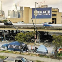 Homeless people camp near the freeway in Austin, Texas, on Tuesday, Oct. 20, 2020.