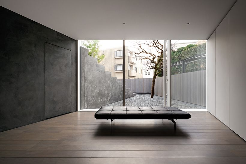 Empty room with a bench and glass walls.