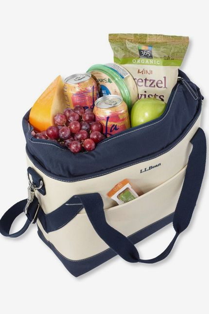 A canvas insulated tote filled with fruit and other snacks