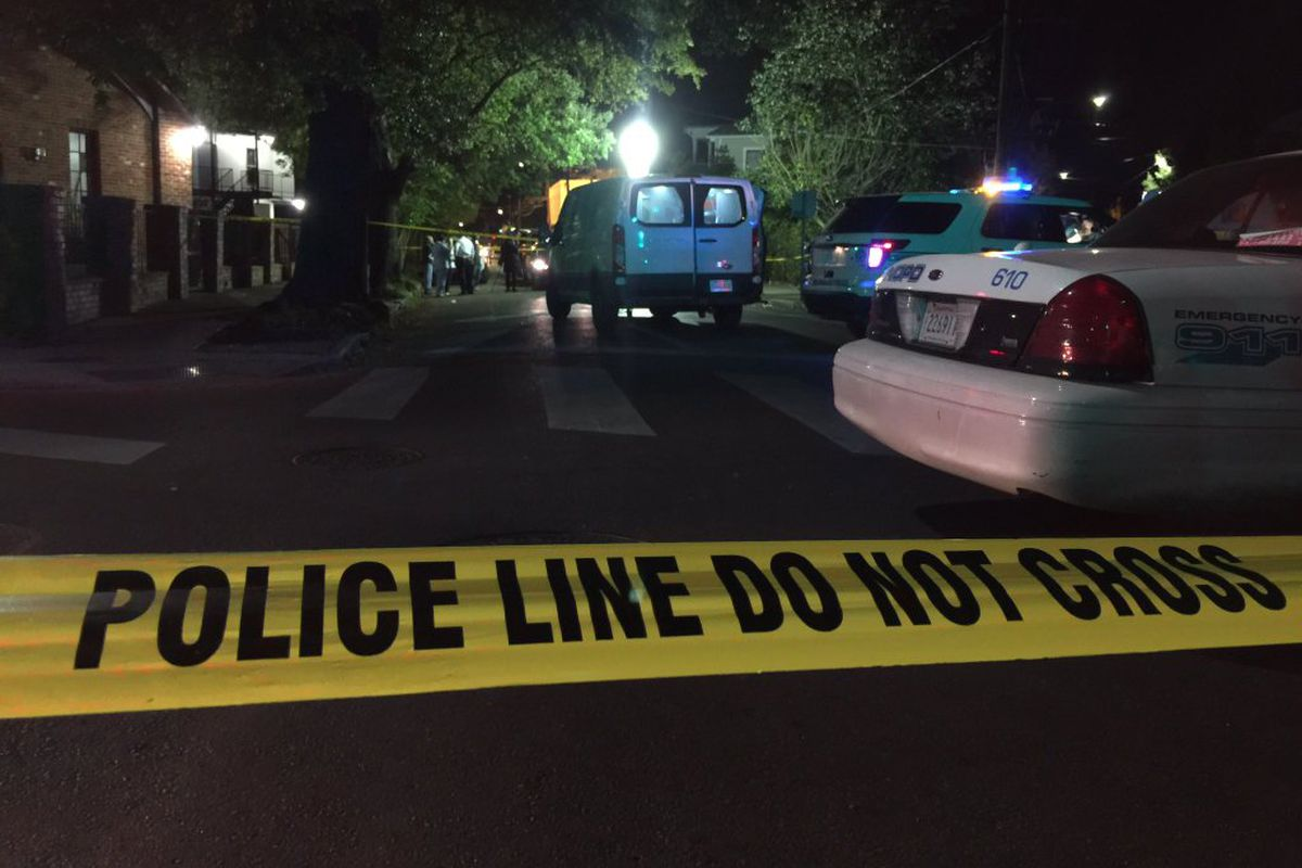 (Above) The Lower Garden District was abuzz with police last night after the shooting death of Will Smith