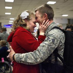 Dianna Azevedo is reunited with her husband, Senior Airman Chris Azevedo at the Salt Lake City International Airport on Wednesday, March 9, 2011.   About 30 Air Force Reservists from Hill Air Force Base's 419th Fighter Wing returned from a six-month deployment to Afghanistan.