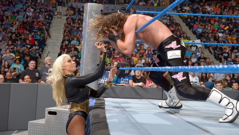 Maryse sprays Ziggler in the face with an unknown substance, setting The Miz up for his finisher and the win.