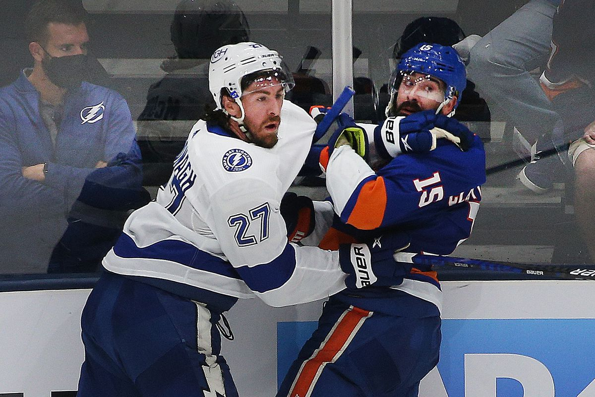 New York Islanders right wing Cal Clutterbuck (15) and Tampa Bay Lightning defenseman Ryan McDonagh (27) come together at the boards during the third period of game four of the 2021 Stanley Cup Semifinals at Nassau Veterans Memorial Coliseum.
