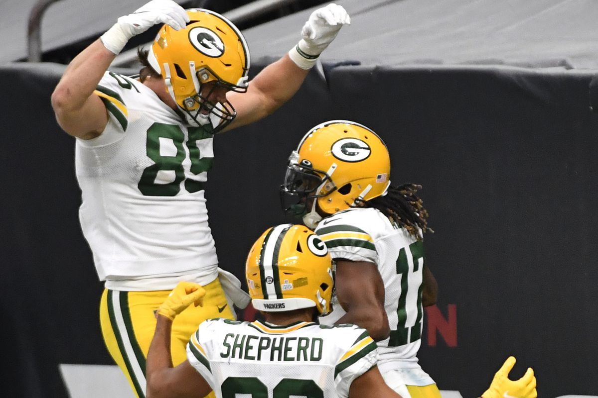 Davante Adams #17 of the Green Bay Packers celebrates with teammates after a 45-yard touchdown reception against the Houston Texans during the third quarter at NRG Stadium on October 25, 2020 in Houston, Texas.