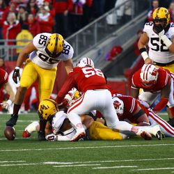 Micheal Caputo falls on a fumble at the end of the first half