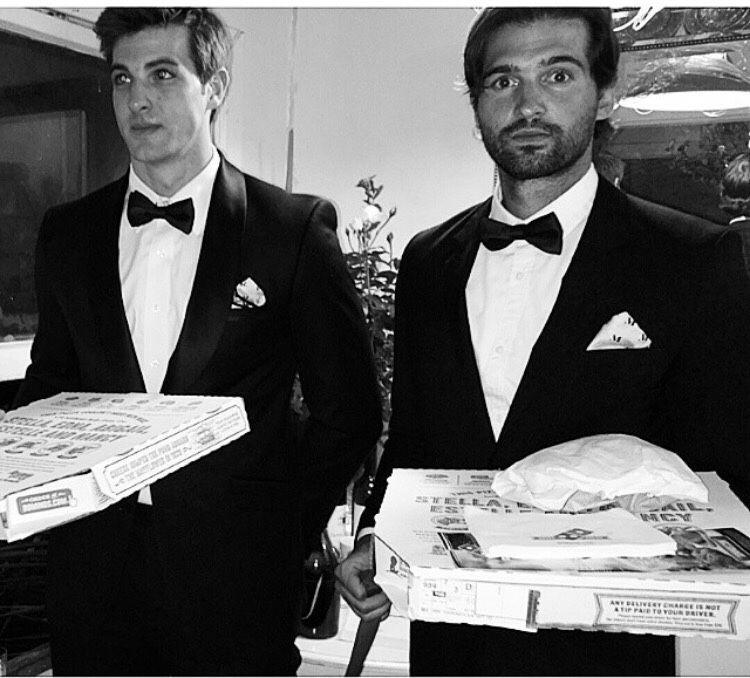 Two ManServants deliver pizza.