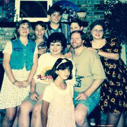 Debbie and Gerry Oden with their four children and two foster children shortly before they adopted them — Richard (second from left) and Laura (front, kneeling) — in May 1995. Standing back row from left: Amy, Richard, Lane, Wes and Kristen.